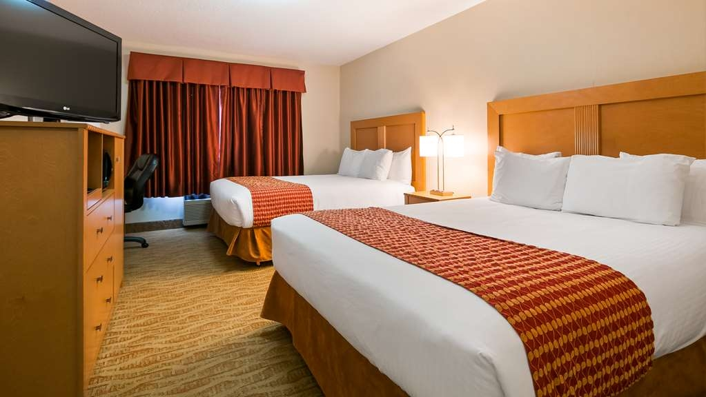 Best Western Grande Prairie Hotel & Suites - Touring the city with a close friend? Book our convenient 2 queen bed guest room.