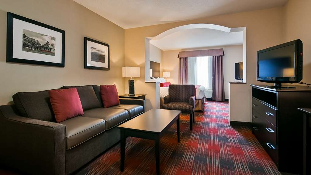 Best Western Plus Red Deer Inn & Suites - Family suite has a king bed, queen pull out sofa bed and a separate bedroom with 2 single beds.