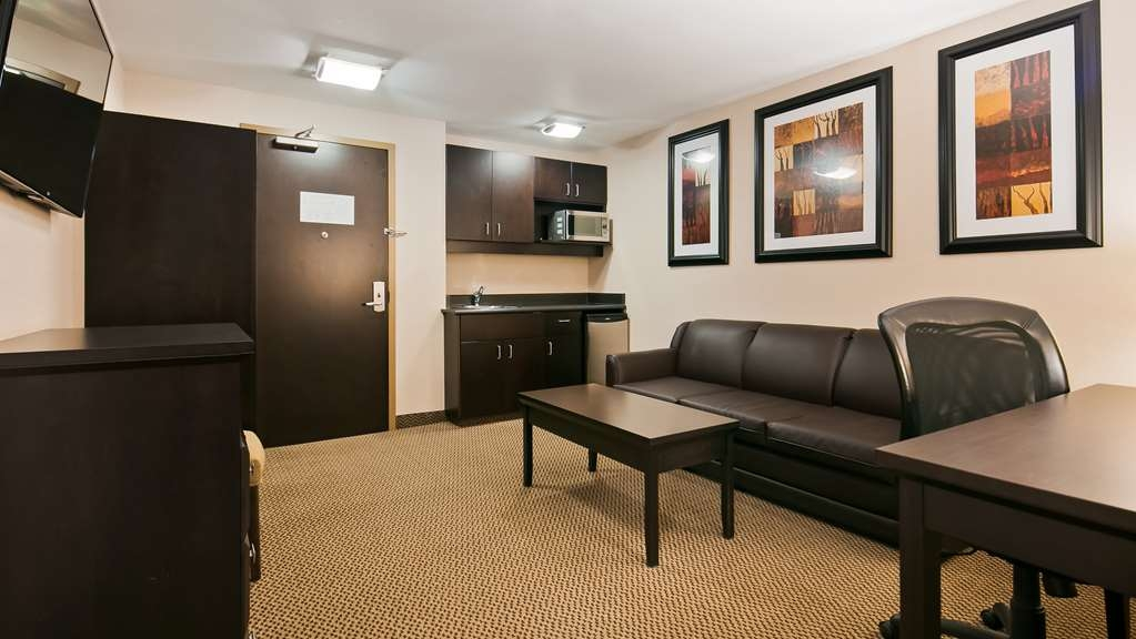 Best Western Bonnyville Inn & Suites - Spend some time after a hectic day in the living room featured in our Executive Suites with wet bar.