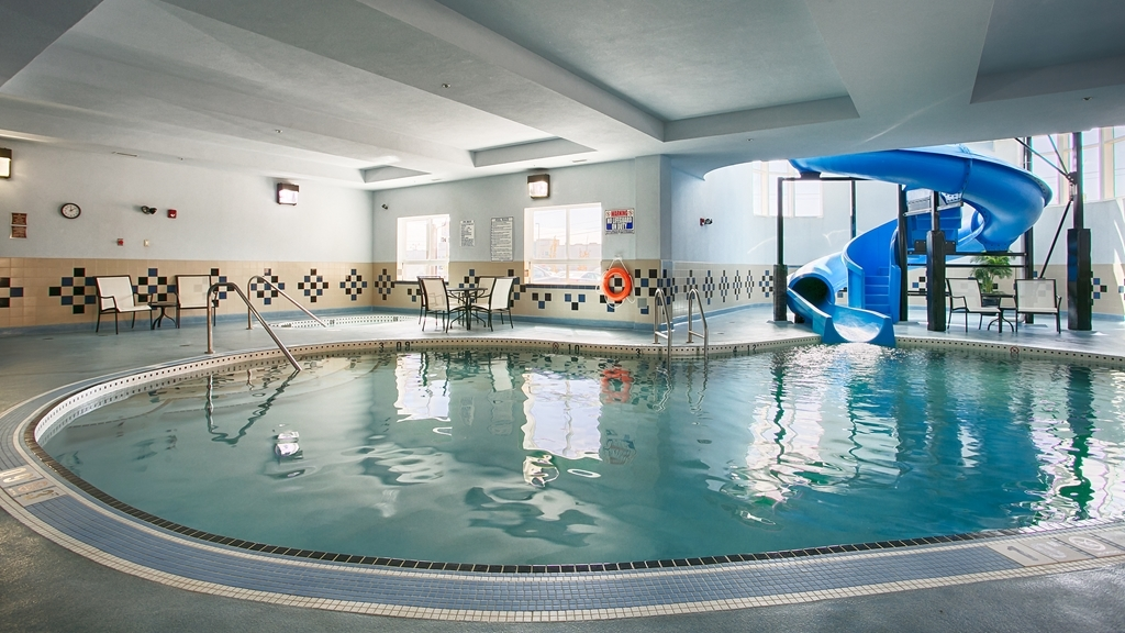 Best Western Premier Freeport Inn & Suites - Enjoy a swim in our indoor heated pool with water slide! Unwind in our hot tub after a long day!