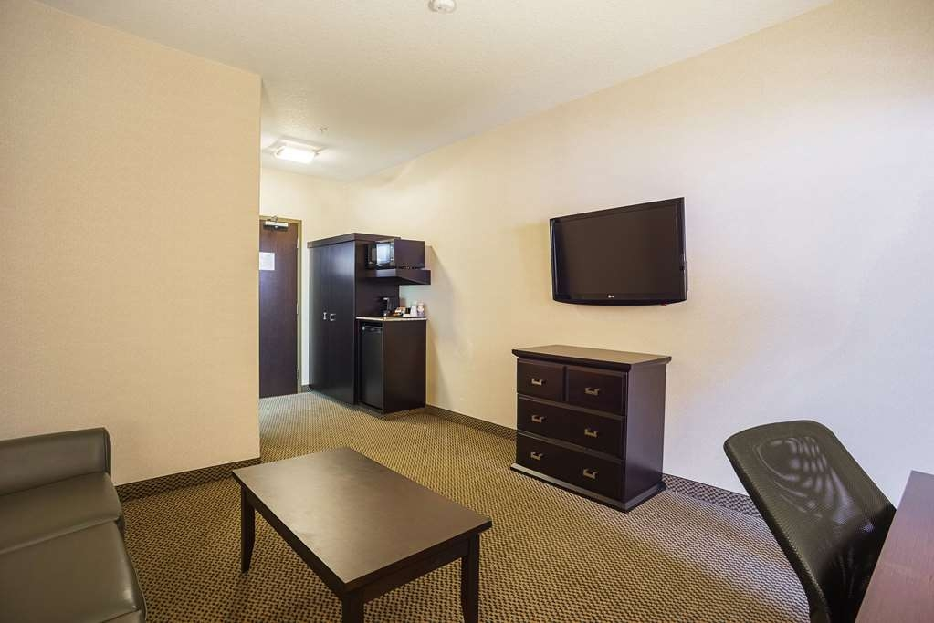 Best Western Plus The Inn at St. Albert - Use the separate living room in our suites for entertaining, and keep your sleeping area private.