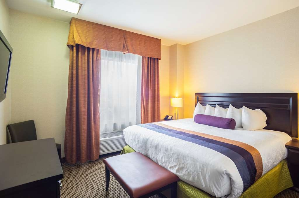 Best Western Plus The Inn at St. Albert - Book our king suites with separate bedroom area so you can stretch out and relax!
