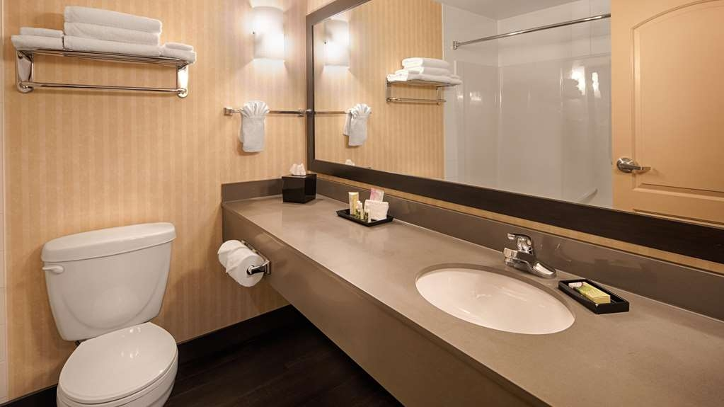 Best Western Plus Meridian Hotel - All guest bathrooms have a large vanity with plenty of room to unpack the necessities