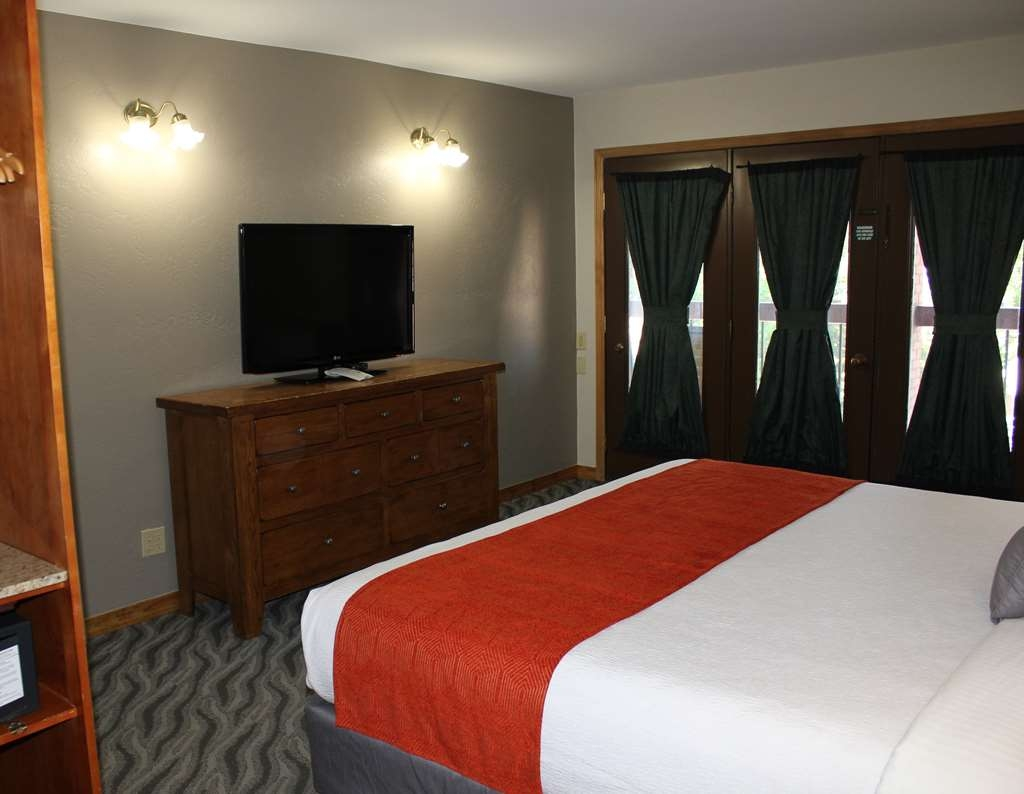 "Best Western Plus Rio Grande Inn - Our King Suite features a King bed in the bedroom and a queen size pullout sofa sleeper in the living room area. The bedroom and living area each have a 42"" flat screen television."