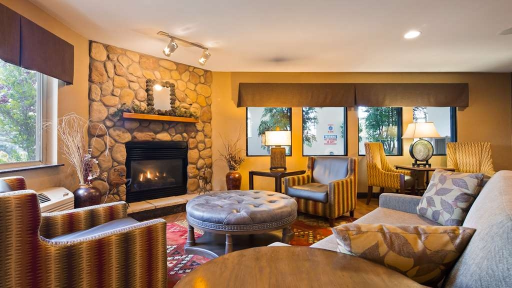 Best Western Plus Deer Park Hotel and Suites - If you're here in the winter, keep warm by the fireplace in our hotel lobby.