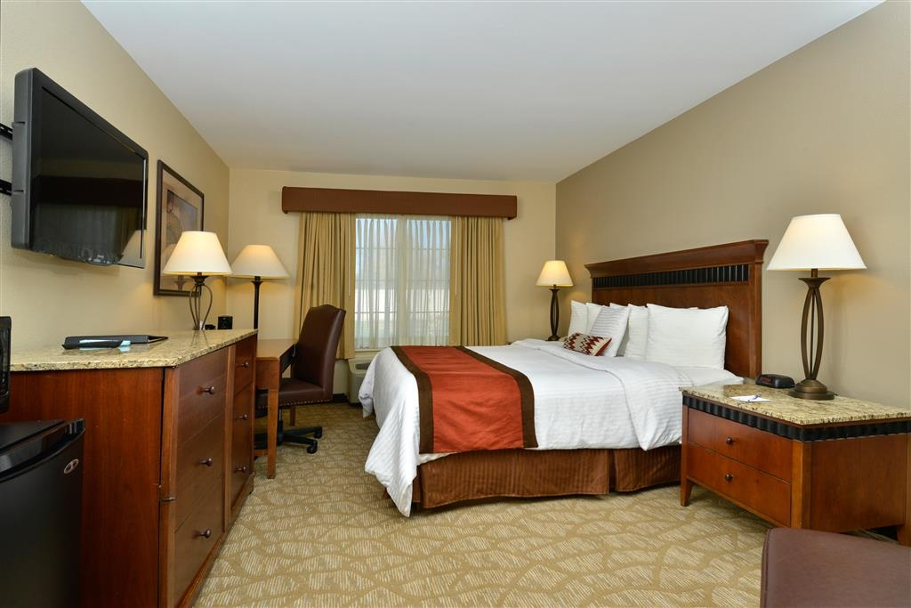 Best Western Denver Southwest - Our newly renovated guest rooms offer upgraded furniture and fixtures including granite vanity countertops and marble topped entertainment centers and night stands.