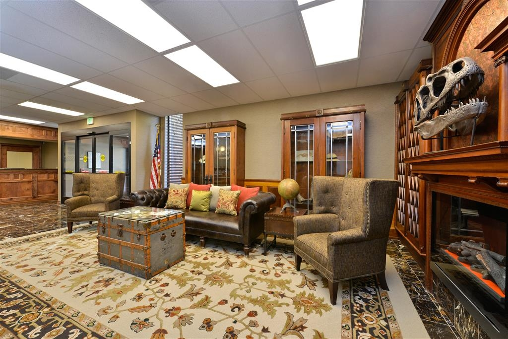 Best Western Denver Southwest - Relax by the fireplace in our lobby after a long day of travel.