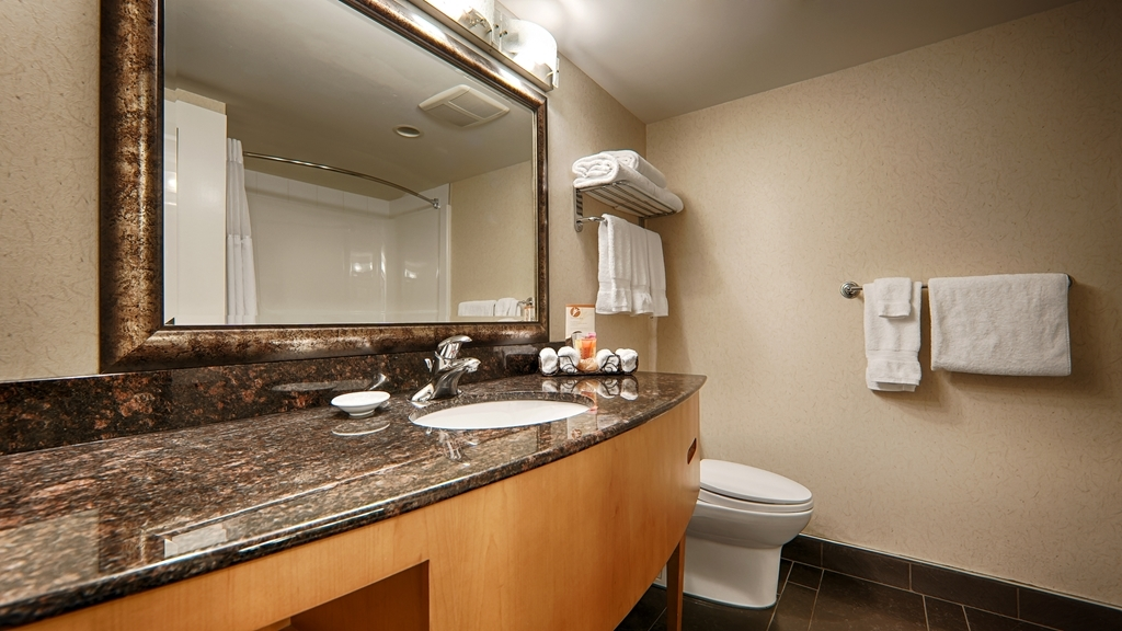 Best Western Plus Kelowna Hotel & Suites - All guest bathrooms have a large vanity with plenty of room to unpack the necessities.