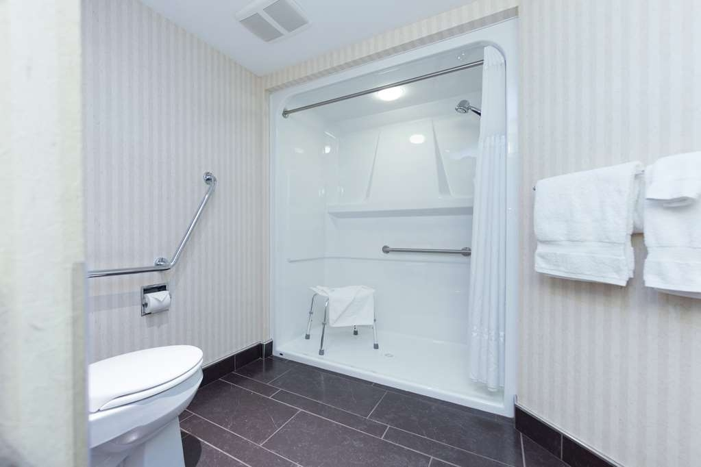 Best Western Plus Kelowna Hotel & Suites - ADA Mobility Accessible Bathroom with 1-inch Lip to Roll In Shower, One Queen Bed