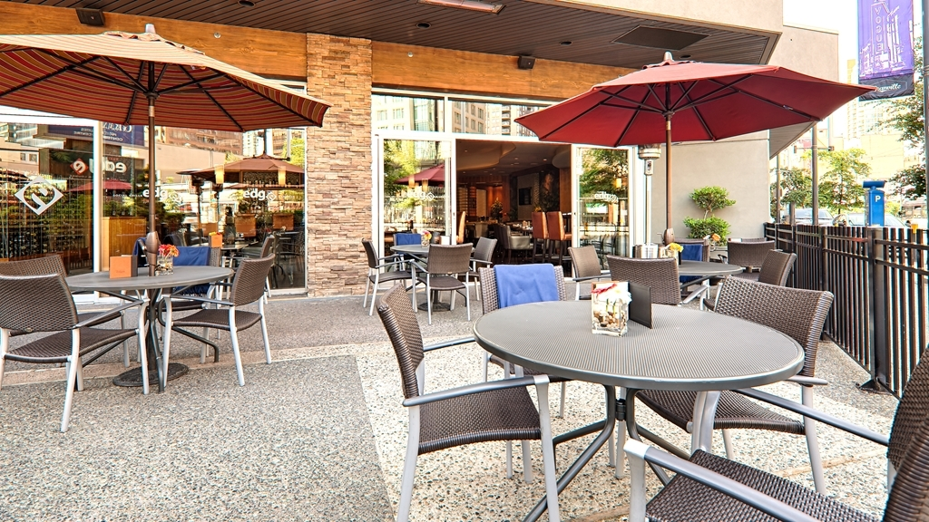 Best Western Plus Chateau Granville Hotel & Suites & Conference Ctr. - Enjoy The Edge Social Grille & Lounge oversized scenic patio with sweeping views of Granville street.