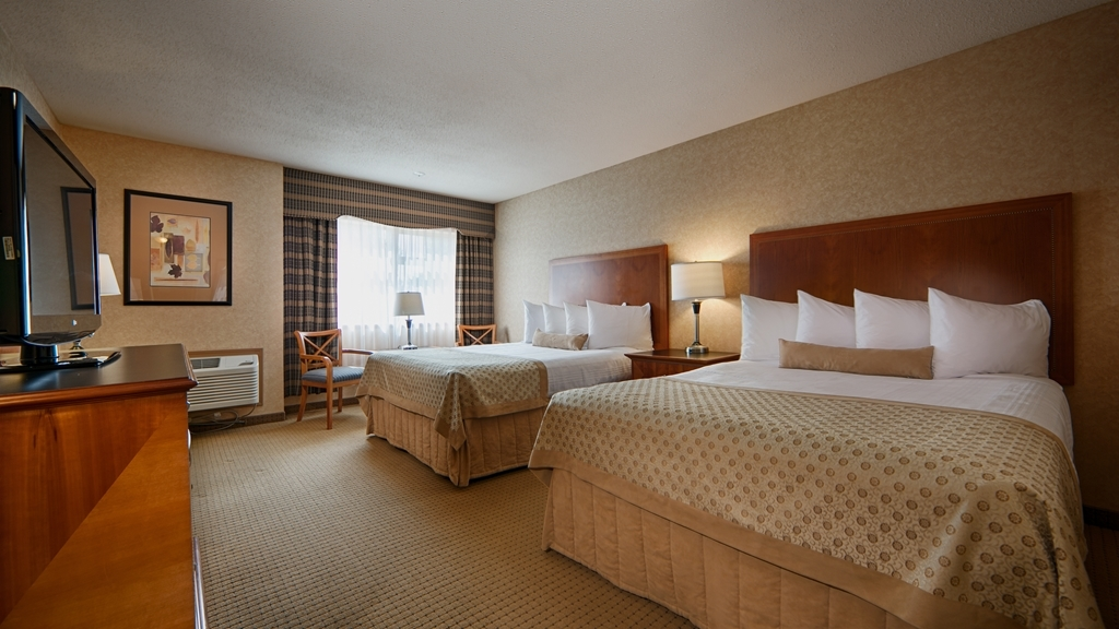 Best Western Plus Langley Inn - Sink into our comfortable beds each night and wake up feeling completely refreshed.