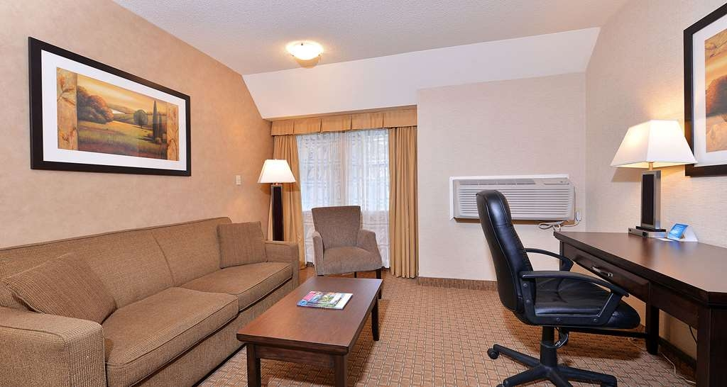 Best Western Plus Emerald Isle Hotel - One King Bed Guest Room with Hide-A-Bed Couch