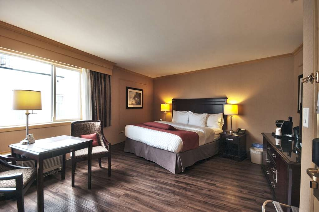 Best Western Dorchester Hotel - Standard King room, One King bed, One Parson table with two chairs, Complimentary Coffee/Tea Maker, Flat Screen TV, Fridge, Iron/Iron Board