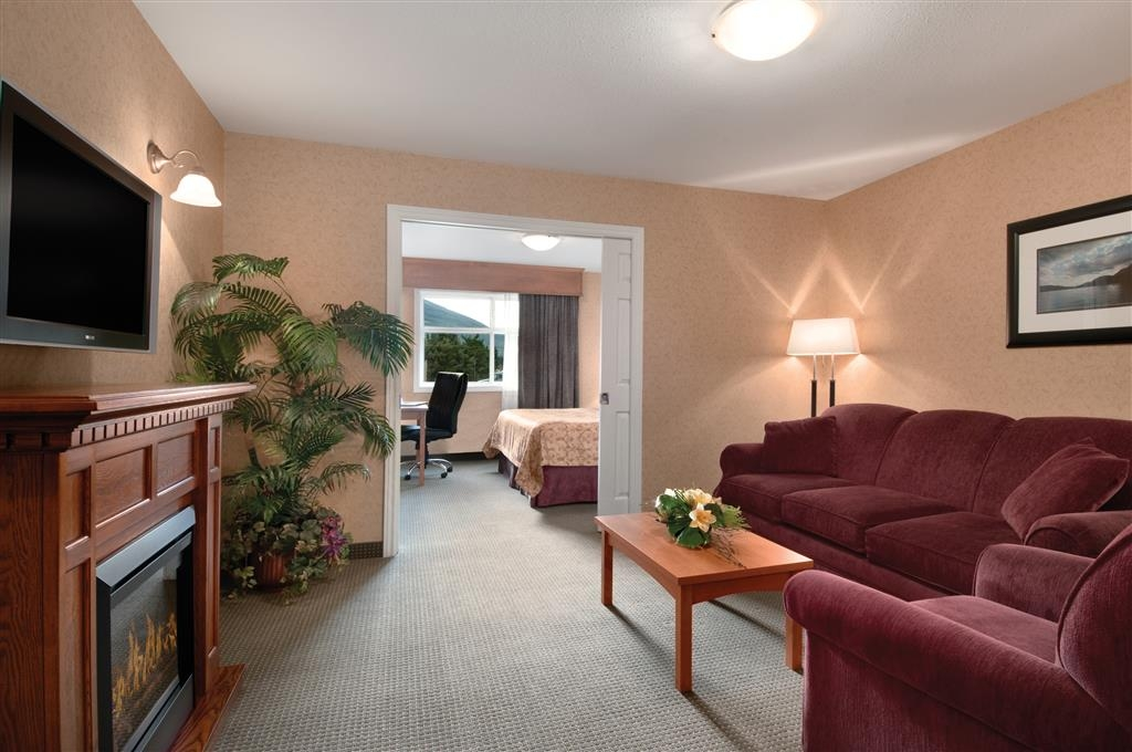 Best Western Sicamous Inn - Our Junior Suite with king bed is separated by pocket doors. Sitting room includes a queen sofa bed, fireplace and flat screen TV.