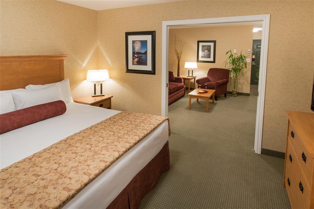 Best Western Sicamous Inn - There is a king bed in the bedroom area and an additional queen sofa in the sitting area.