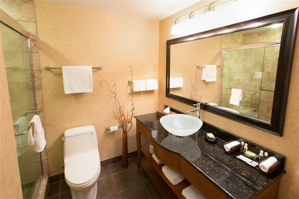 Best Western Sicamous Inn - Elegant tiled shower complete with a bench is just another upgrade offered in the Premier rooms.