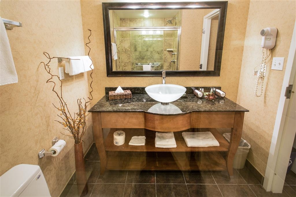 Best Western Sicamous Inn - Upscale bathroom in Premier Room, with glass vessel sink and granite counters.