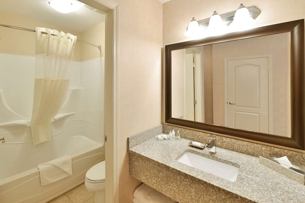 Best Western Cranbrook Hotel - Guest Bathroom - Tub/shower combo and toilet in one room, sink separate.