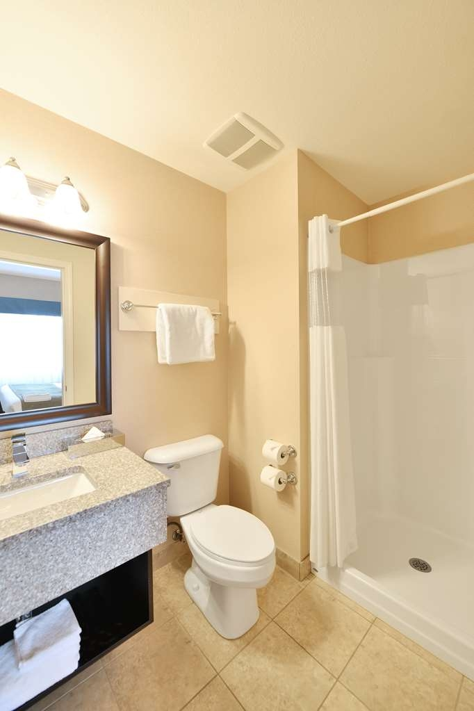 Best Western Cranbrook Hotel - Two Bedroom Suite Ensuite has a stand alone shower, toilet and sink.