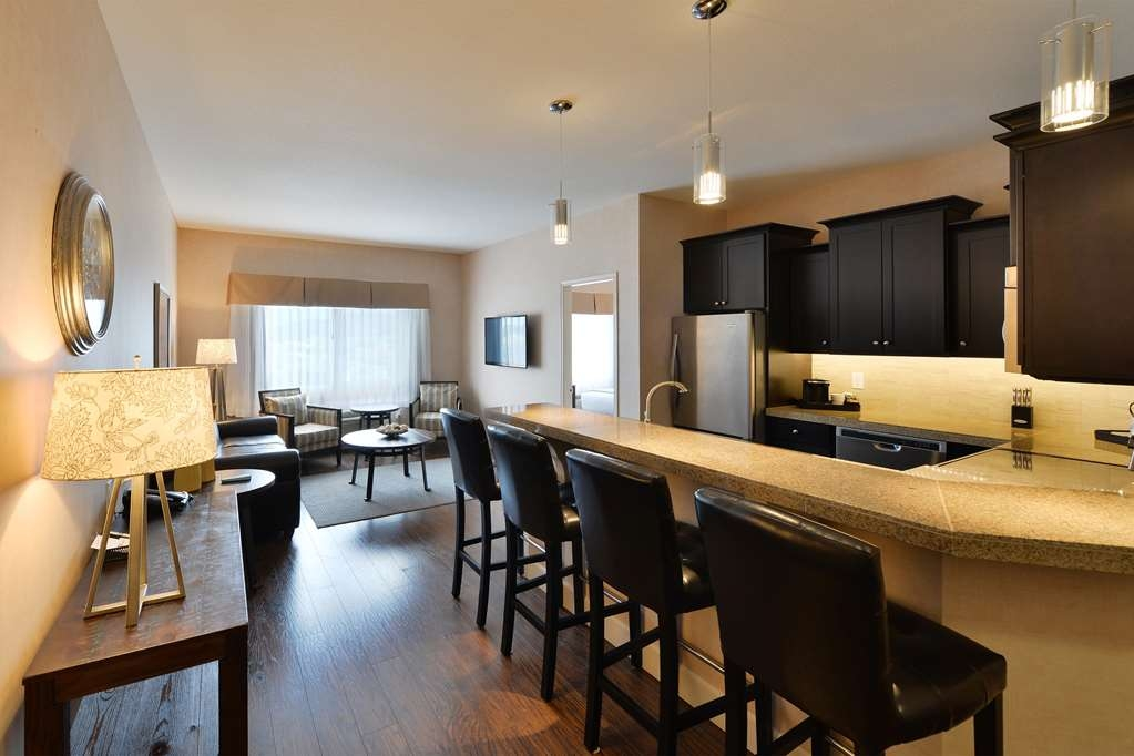 Best Western Cranbrook Hotel - Condo Suite beautiful kitchen has full-size refrigerator, dishwasher, oven/stovetop & microwave with a breakfast bar.