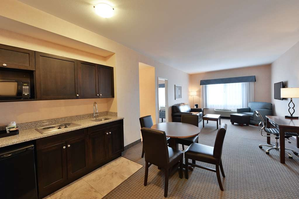 Best Western Cranbrook Hotel - One Bedroom King Suite in separate bedroom and pull out leather sofa bed in living room. Also has a small kitchen.