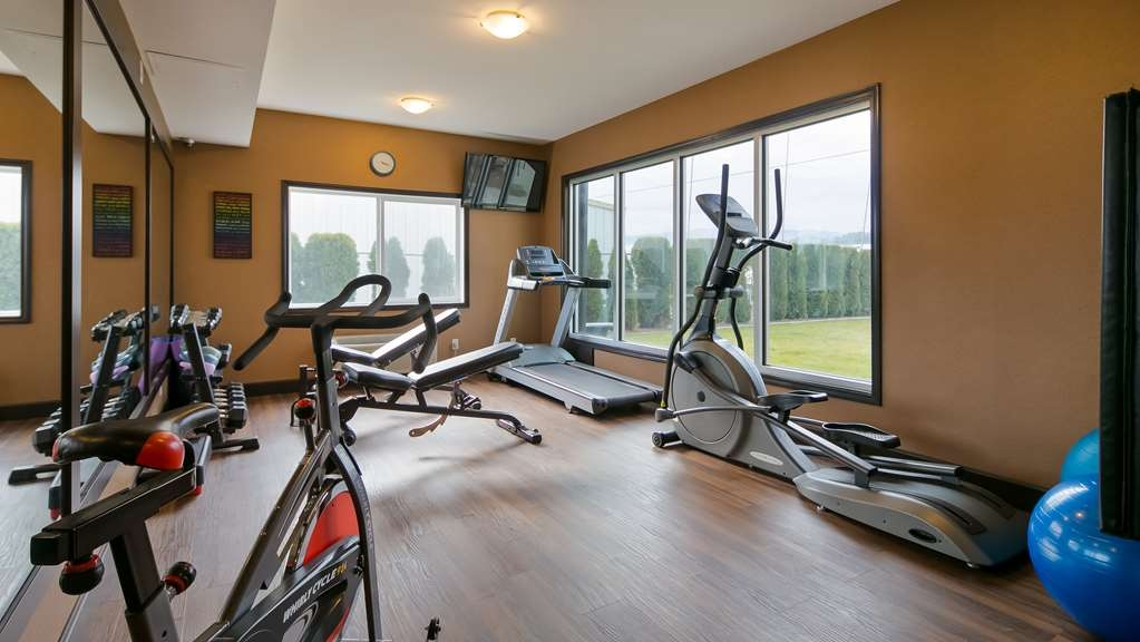Best Western Cranbrook Hotel - Fitness Center consists of a treadmill, elliptical machine, stationary bike and weights.