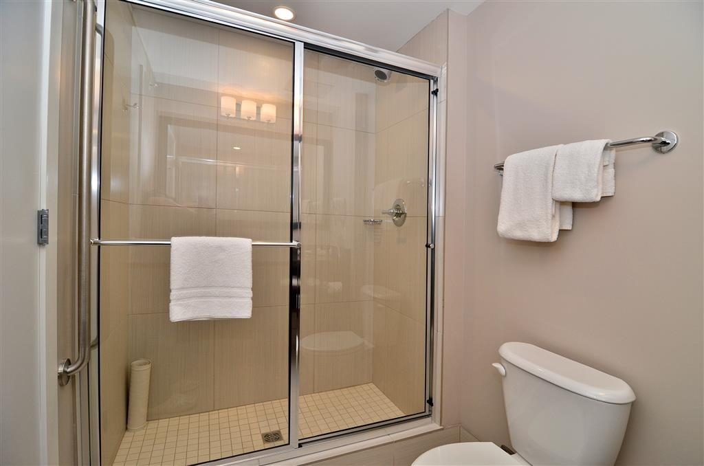Best Western Plus Revelstoke - A few king room feature a large glass enclosed shower instead of a bathtub.