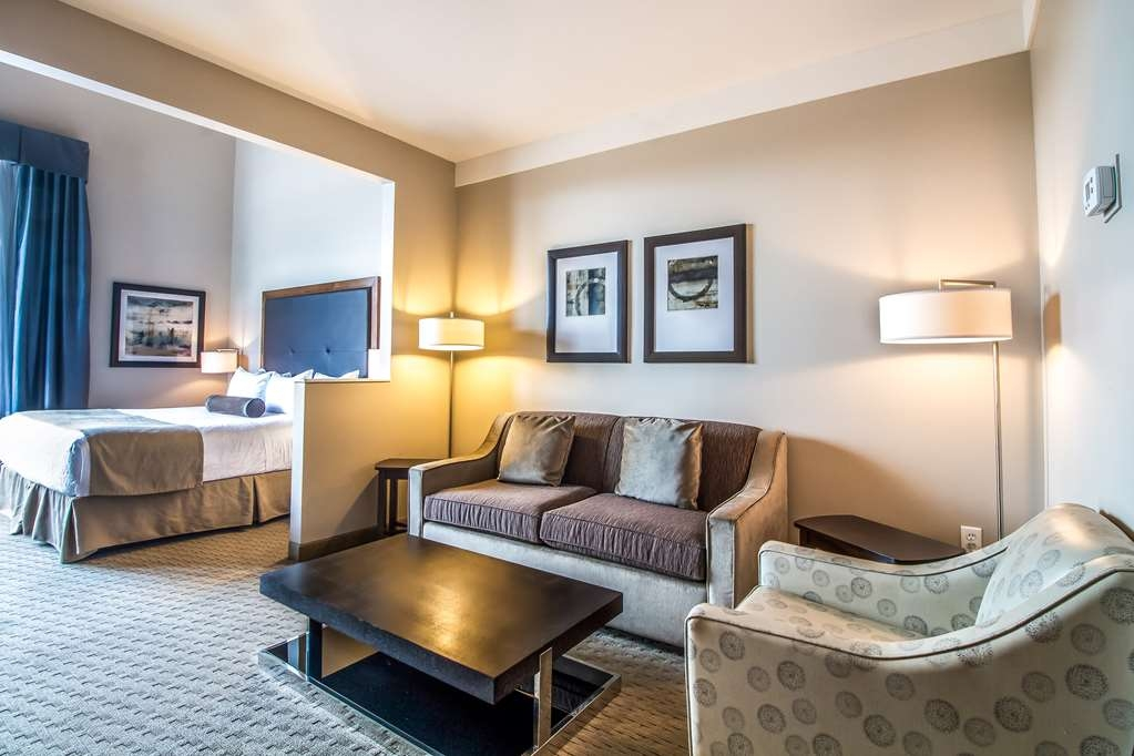 Best Western Plus Revelstoke - The seating area in our king suites feature an arm chair and comfortable sofa that folds out to a double size hide-a-bed.