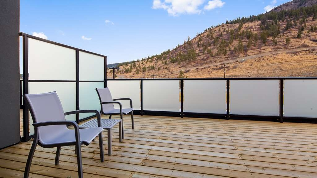 Best Western Plus Merritt Hotel - Relax and enjoy the mountain views with a nice glass of wine on one of our over sized patios.
