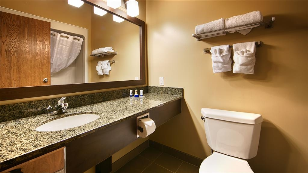 Best Western Plus Saint John Hotel & Suites - Our guest bathrooms provide plenty of granite counter top space and large vanity mirrors.
