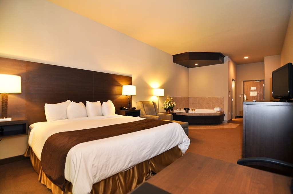 Best Western Plus Saint John Hotel & Suites - Our King Whirlpool room includes one king bed, whirlpool, hot buffet breakfast, Wi-Fi, mini-fridge, microwave, coffee maker, free local calls, parking.
