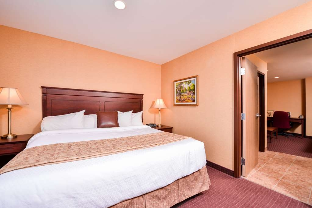 Best Western Plus Fredericton Hotel & Suites - Book a room in our king mini suite featuring french doors, microwave and refrigerator.