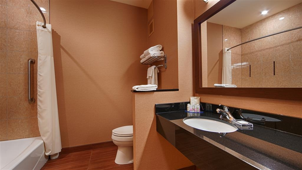 Best Western Plus Bathurst Hotel & Suites - Our guest bathrooms are equipped with granite counter tops and large vanities so you can prepare for the day!