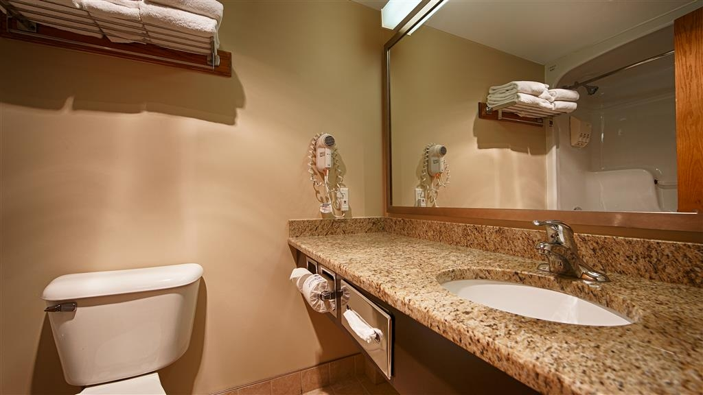 Best Western Plus Guildwood Inn - Clean spacious bathrooms with all of the amenities you need.