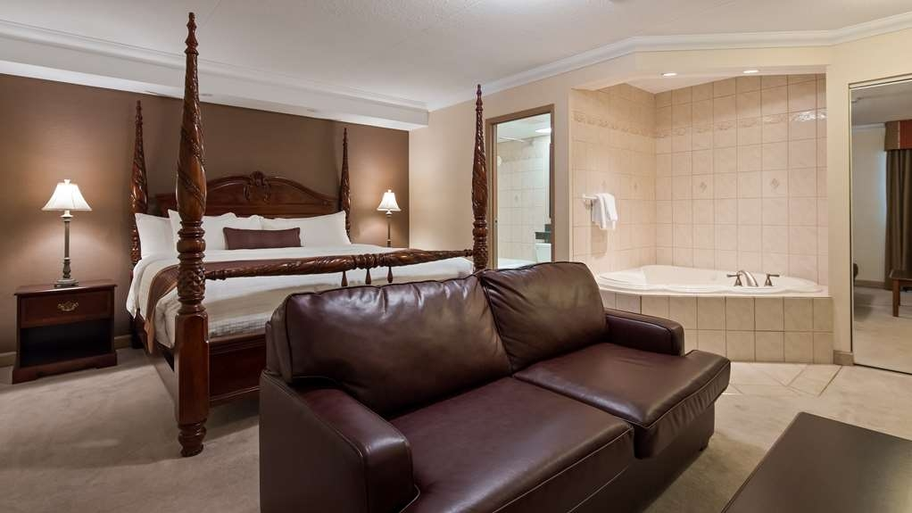 Best Western Plus Cobourg Inn & Convention Centre - King 4 poster bed and double sofa bed in our Honeymoon Suite