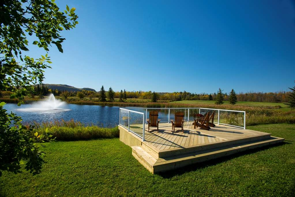 Best Western Plus NorWester Hotel & Conference Centre - Relax and Enjoy the Views of the Nor'Wester Mountains from our Pond Area