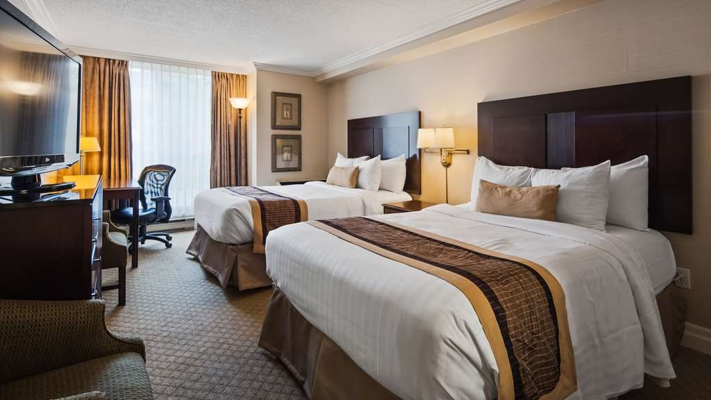 Best Western Plus Ottawa Downtown Suites - Two double sized beds, working desk area, cordless phone and kitchenette with microwave, coffee maker, mini refrigerator and dinnerware.