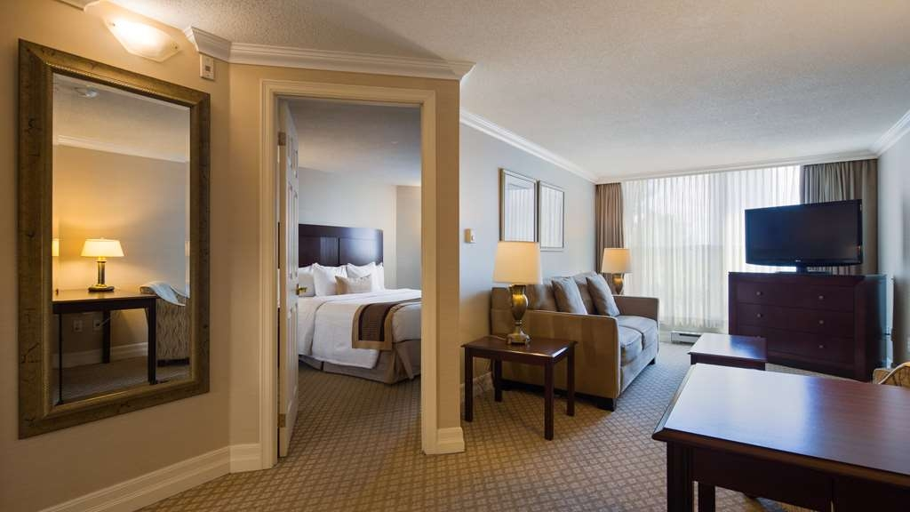 Best Western Plus Ottawa Downtown Suites - One queen bed, separate living room with sofa bed, work desk, cordless phone, kitchenette with microwave, single serve coffee maker and dinnerware.