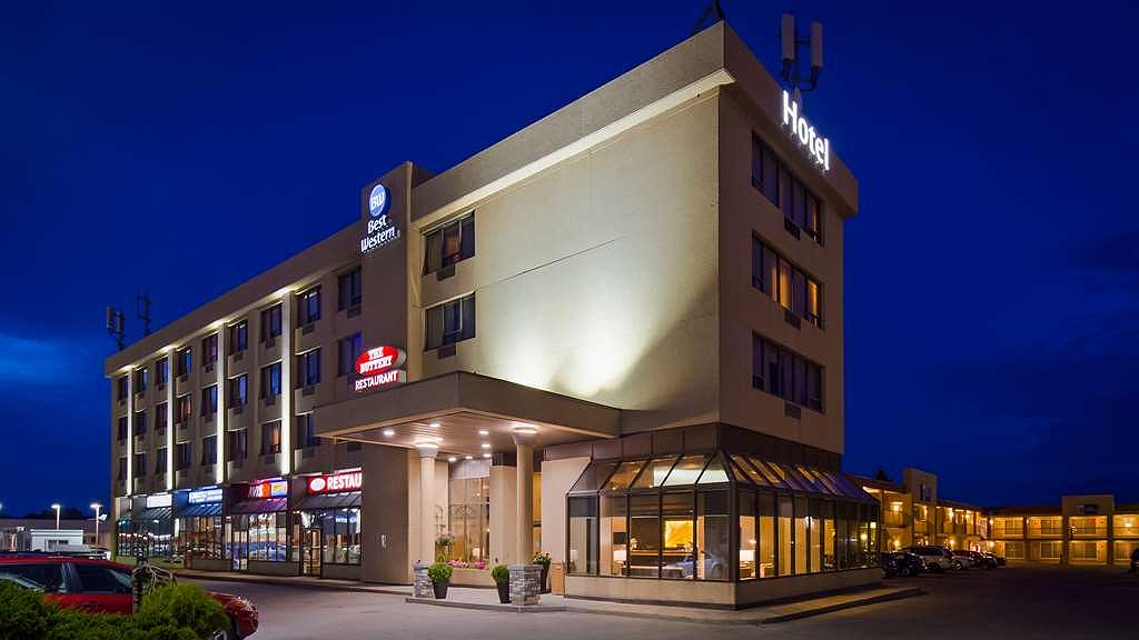 Best Western Voyageur Place Hotel - Hotel exterior at dusk. Located at the corner of Yonge St. and Davis Drive in Newmarket, ON, right across the street from Upper Canada Mall.