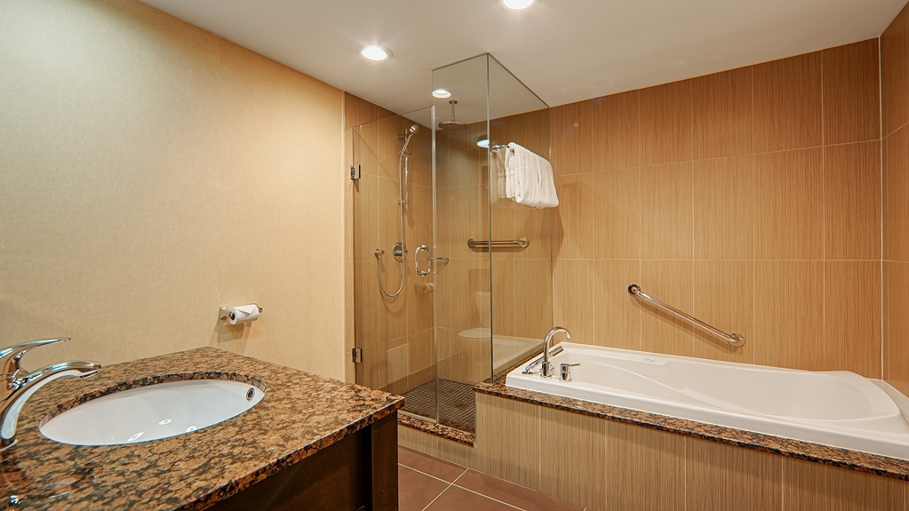 Best Western Voyageur Place Hotel - Enjoy total relaxation in our air jetted tub and rain shower in our king suite bathroom.