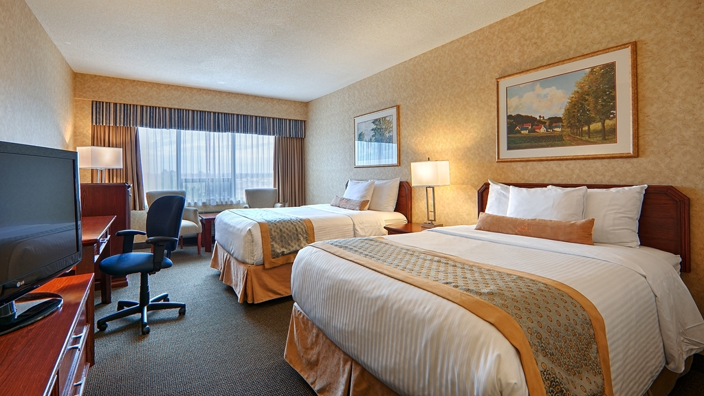 Best Western Voyageur Place Hotel - This standard room comes with two pillow top double beds, a flat screen HD TV, a mini fridge and more.