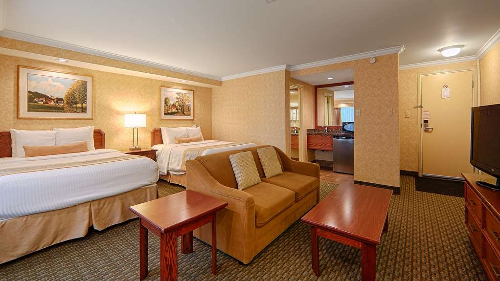 Best Western Voyageur Place Hotel - This two queen bed mini-suite with exterior access offers an efficiency nook with mini refrigerator, microwave, and coffee maker.