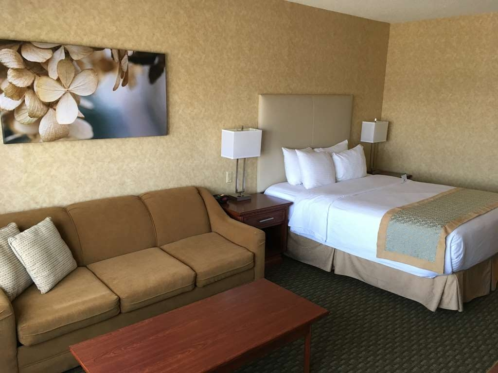Best Western Voyageur Place Hotel - This cozy queen guest room offers a double sofa bed, 37-inch HD LCD TV, cozy pillow top bed, mini refrigerator, microwave, coffee maker, and free wireless Internet.