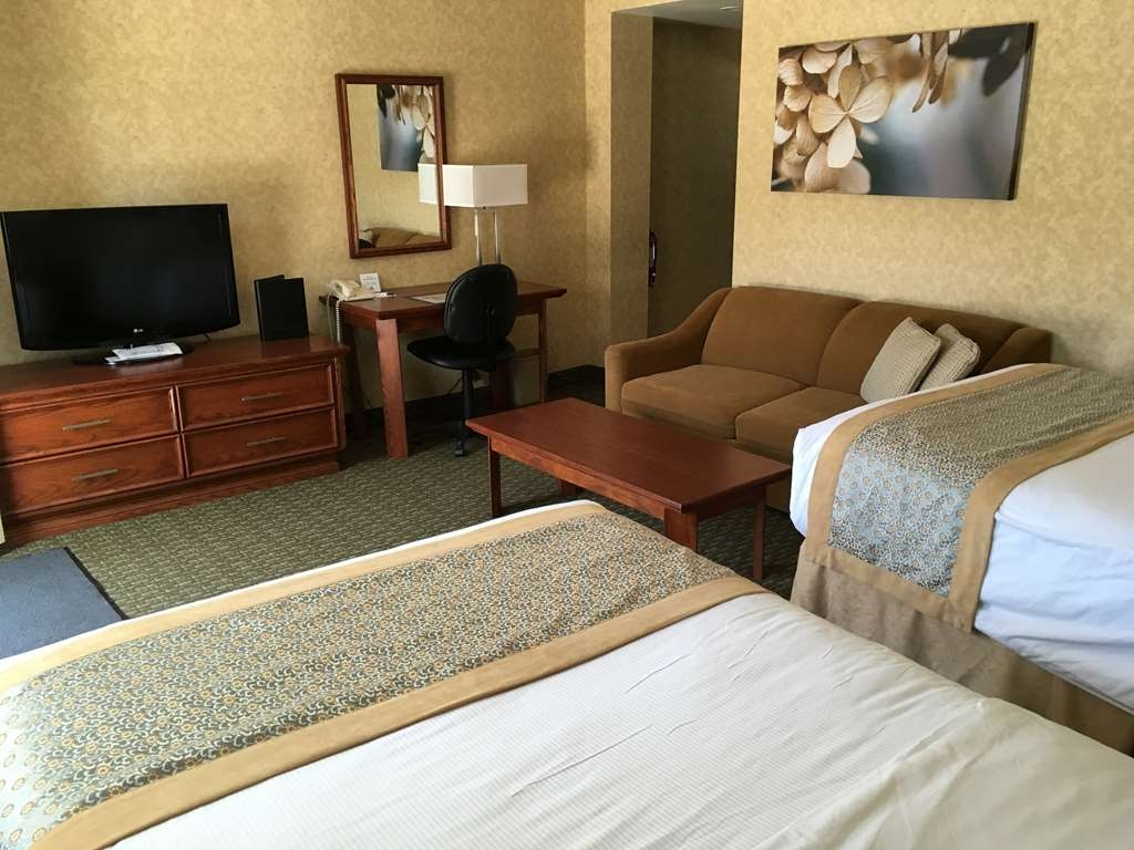Best Western Voyageur Place Hotel - This is a 2 Double bed and double pullout sofa bedroom with a kitchenette.