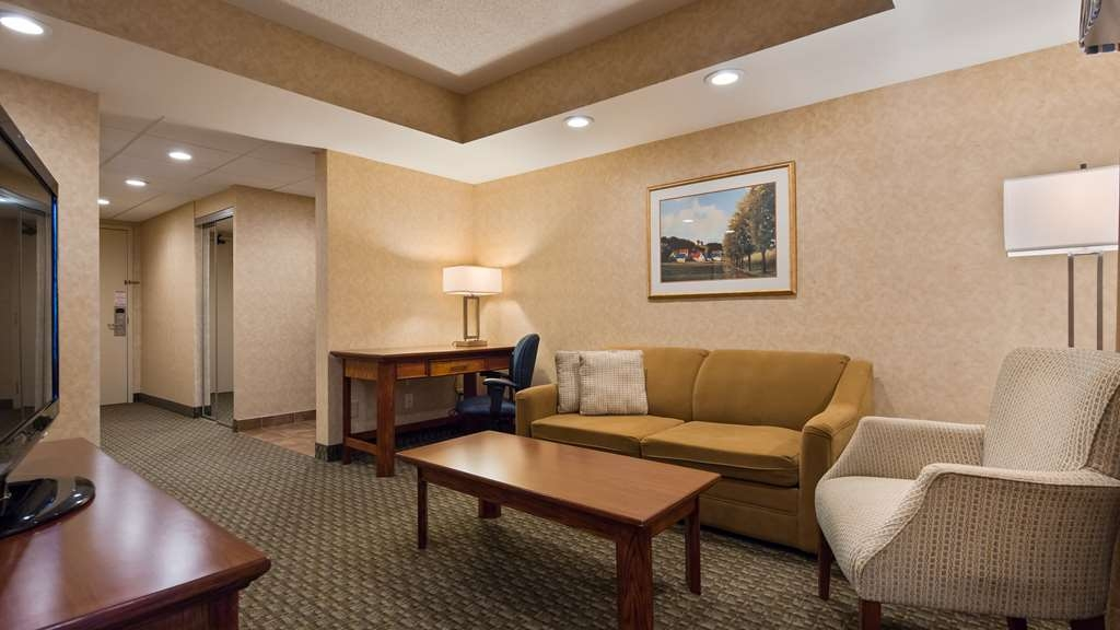 Best Western Voyageur Place Hotel - This large suite with privacy wall between the bedroom and sitting area features two HD TV's, a mini refrigerator, coffee maker, and microwave.