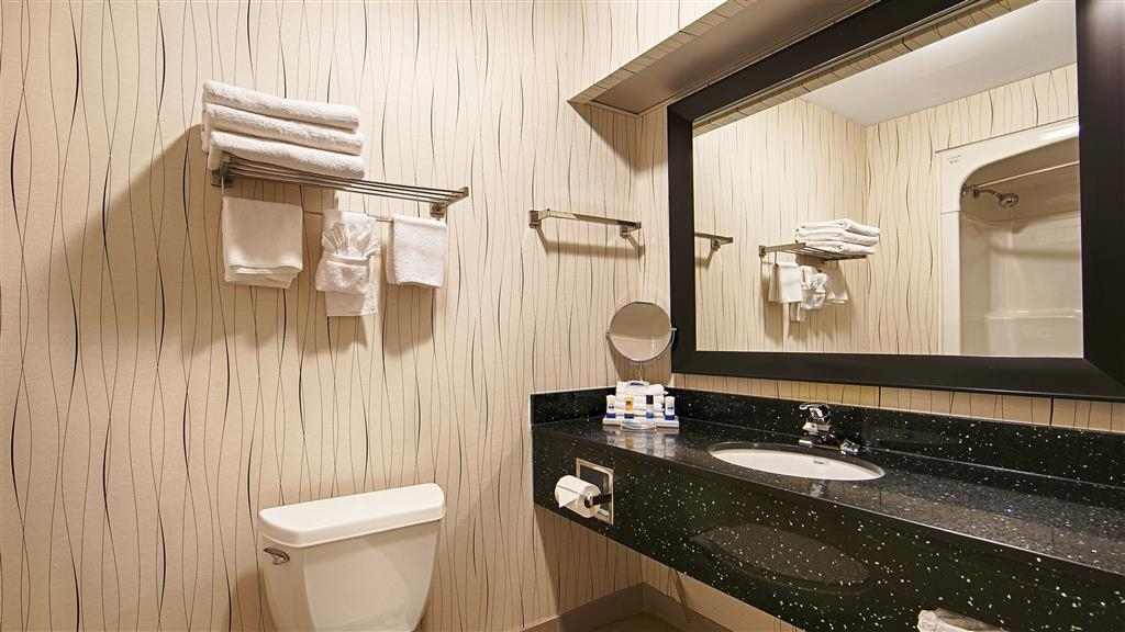 Best Western Plus Travel Hotel Toronto Airport - We offer a modern vanity with complimentary shower cap, shampoo, conditioner, mouthwash, facial soap and bath soap.
