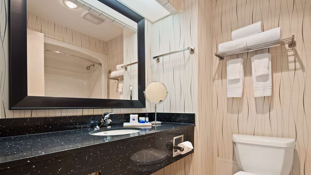 Best Western Plus Travel Hotel Toronto Airport - Guest Bathroom,We offer a modern vanity with complimentary shower cap, shampoo, conditioner, mouthwash, facial soap and bath soap.