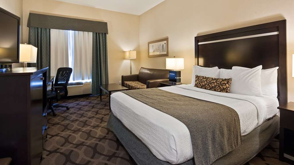 Best Western Plus Travel Hotel Toronto Airport - 1 Queen Size Room - contain Microwave, Refrigerator, Single cup coffee maker, Vanity Mirror, Iron & Ironing Board.