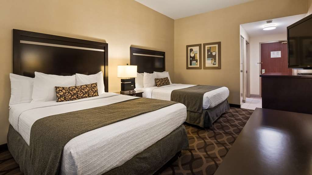Best Western Plus Travel Hotel Toronto Airport - 2 Queen Beds Guest Room - contain Microwave, Refrigerator, Single cup coffee maker, Vanity Mirror, Iron & Ironing Board.