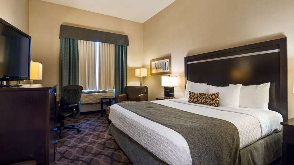 Best Western Plus Travel Hotel Toronto Airport - King Bed - Guest Room contain Microwave, Refrigerator, Single cup coffee maker, Vanity Mirror, Iron & Ironing Board.